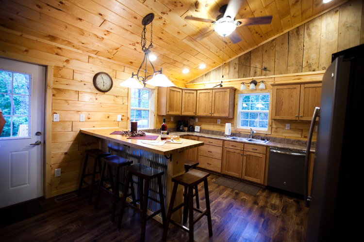 Step into the great room, featuring a large wood burning fireplace and groove vaulted ceilings and walls. Windows provide natural light and awesome views of the surrounding area. The well equipped kitchen and dining room enjoys the same views. The large, open front porch has a swing and rocking chairs where you can listen to the trees quake in the wind and enjoy a morning cup of coffee. Laundry room completes the first floor.
